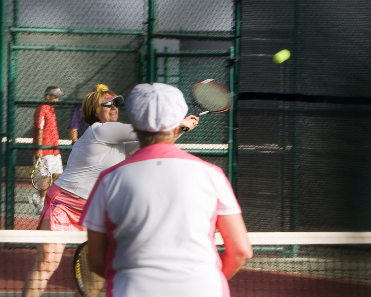 Annette smacks a volley