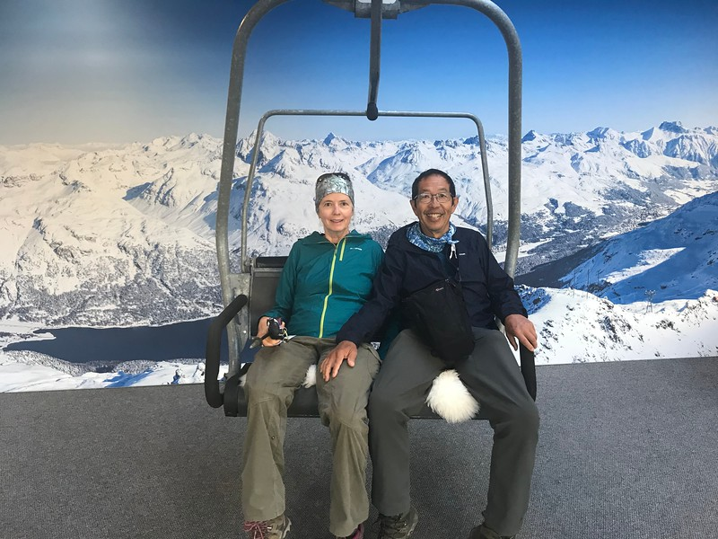 Pretending to ride the chairlift while waiting for the Corvatsch lift