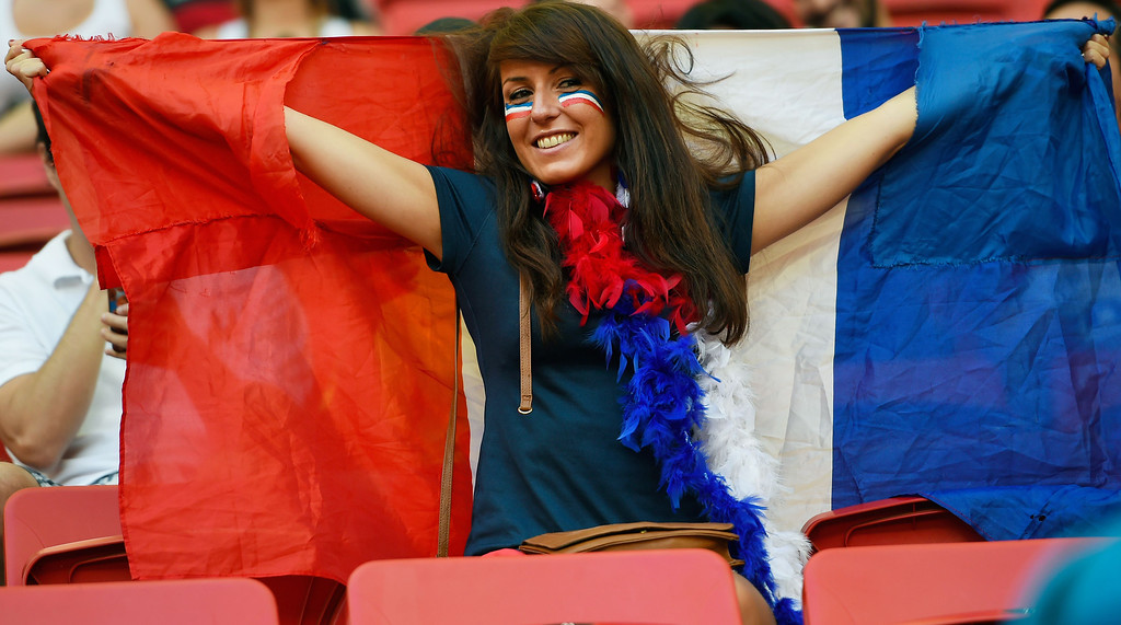 . A France fan cheers prior to a Round of 16 football match between France and Nigeria at Mane Garrincha National Stadium in Brasilia during the 2014 FIFA World Cup on June 30, 2014.       AFP PHOTO / FABRICE  COFFRINI/AFP/Getty Images