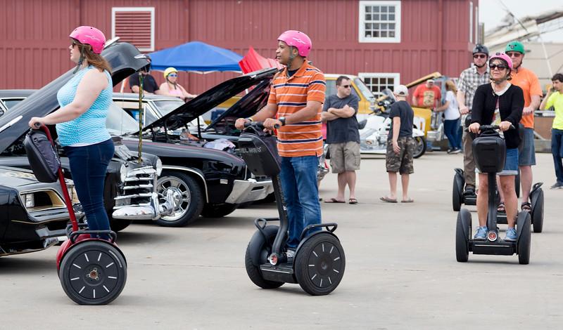 A Segeway parade through the car show