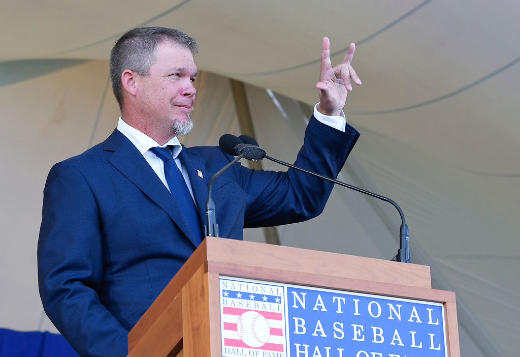 . National Baseball Hall of Fame inductee Chipper Jones peaks during an induction ceremony at the Clark Sports Center on Sunday, July 29, 2018, in Cooperstown, N.Y. (AP Photo/Hans Pennink)