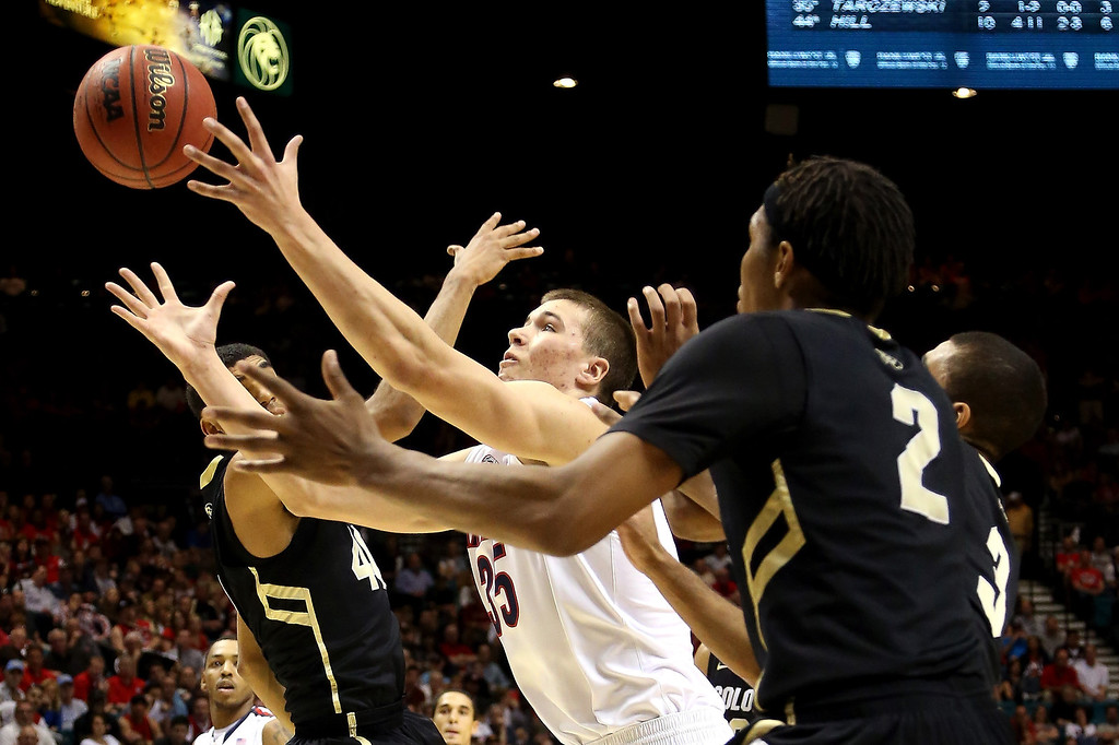 . Kaleb Tarczewski #35 of the Arizona Wildcats goes for a rebound against Xavier Talton #3 and Xavier Johnson #2 of the Colorado Buffaloes in the second half during the quarterfinals of the Pac-12 tournament at the MGM Grand Garden Arena on March 14, 2013 in Las Vegas, Nevada.  (Photo by Jeff Gross/Getty Images)