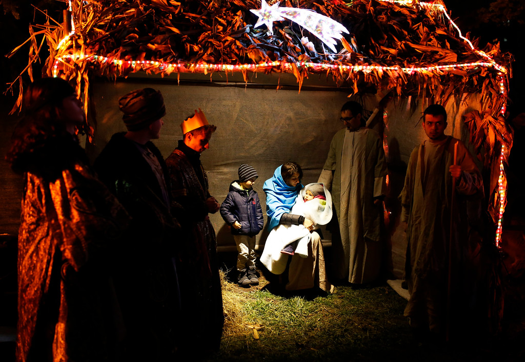 . Volunteers perform a live nativity scene for the upcoming Christmas season, in the Bosnian capital of Sarajevo, Monday, Dec. 18, 2017. The city still keeps the tradition of celebrating holidays of all four religions present in Bosnia - Catholicism, Orthodoxy, Islam and Judaism - despite the 1992-95 war fought between Bosnian Serbs, Croats and Bosnian Muslims.(AP Photo/Amel Emric)