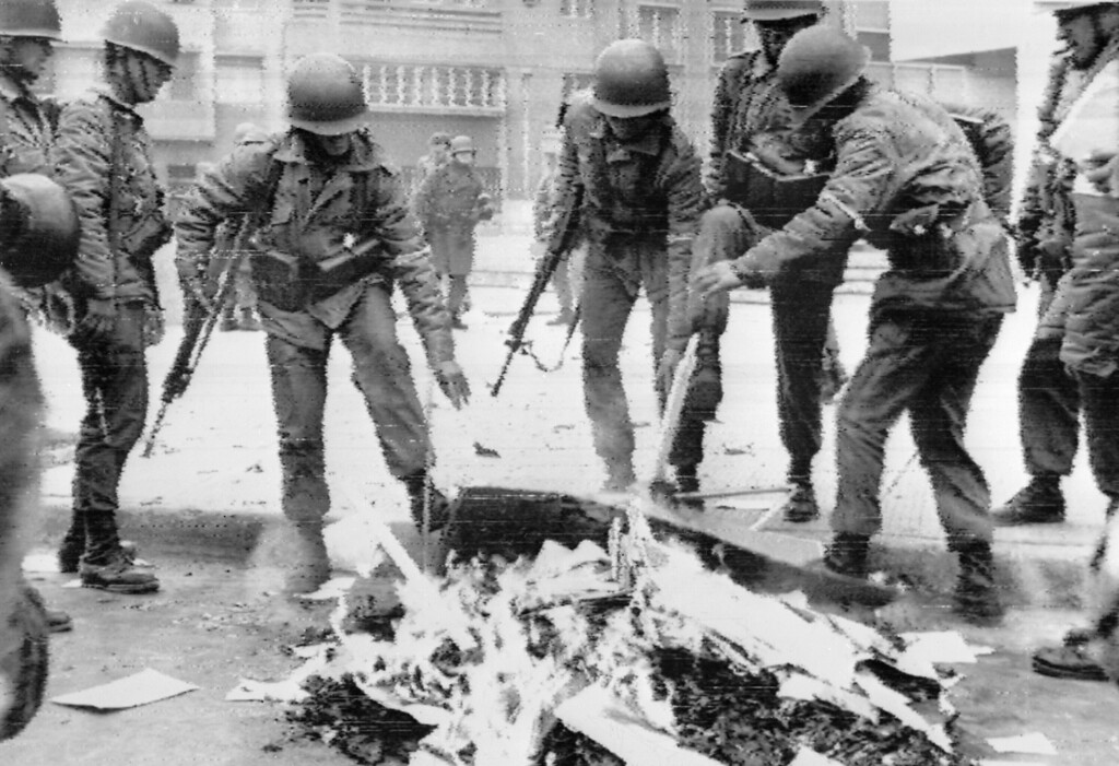 . Chilean soldiers burning Marxist books in the capital city during the military coup, Santiago, 26 September 1973. Presidente Salvador Allende died in the Presidential Palace on the 11 September 1973 and Augusto Pinochet, a career army officer, established himself at the head of the ensuing military regime.  AFP PHOTOHO/AFP/Getty Images