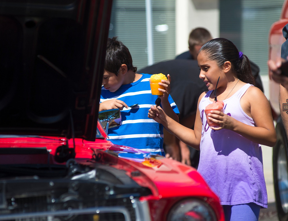 . IDB-L-DBROUTE66-SUN-02 Siblings Adrien Moreno, 10, and Laryssa Perez, 9, of Upland, enjoy a cold treat as they check out the classic cars that  line Euclid Ave in Ontario, on the last day of the  Route 66 Cruisin� Reunion, on Sunday, September 22, 2013. (photos by Frank Perez for the Daily Bulletin)