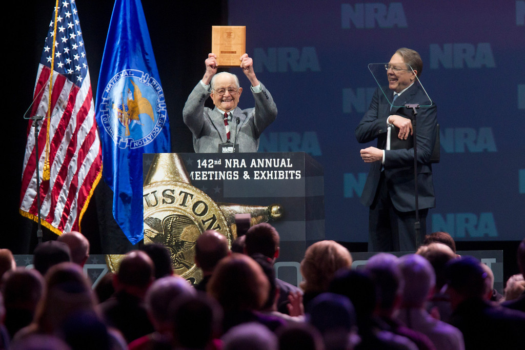 . Born in 1917, the oldest life NRA member in attendance, Wayne Burd, holds up the plaque he received for being a member since 1938 next to Wayne LaPierre, executive vice president of the NRA during the NRA Annual Meeting of Members at the National Rifle Association\'s 142 Annual Meetings and Exhibits in the George R. Brown Convention Center Saturday, May 4, 2013, in Houston. National Rifle Association leaders told members Saturday that the fight against gun control legislation is far from over, with battles yet to come in Congress and next year\'s midterm elections, but they vowed that none in the organization will ever have to surrender their weapons. (AP Photo/Houston Chronicle, Johnny Hanson)