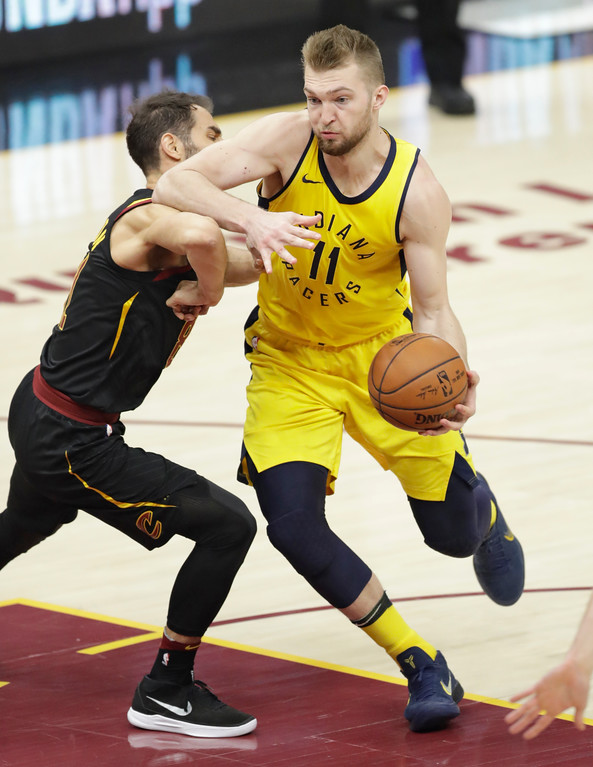 . Indiana Pacers\' Domantas Sabonis (11), from Lithuania, drives past Cleveland Cavaliers\' Jose Calderon (81), from Spain, in the second half of Game 5 of an NBA basketball first-round playoff series, Wednesday, April 25, 2018, in Cleveland. The Cavaliers won 98-95. (AP Photo/Tony Dejak)