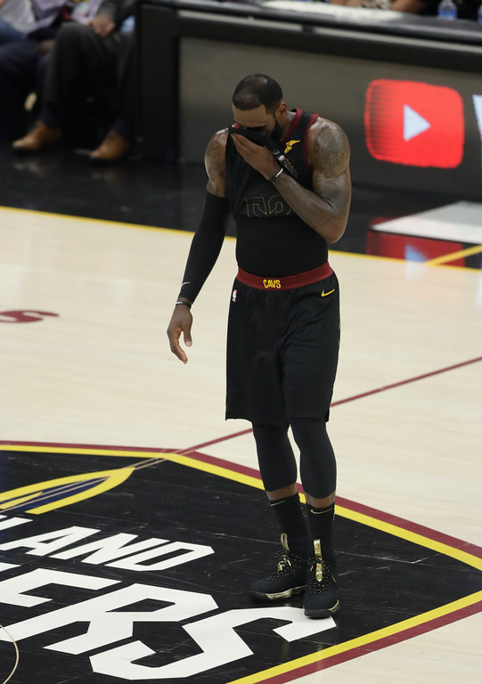 . Cleveland Cavaliers\' LeBron James wipes his face in the first half of Game 4 of basketball\'s NBA Finals against the Golden State Warriors, Friday, June 8, 2018, in Cleveland. (AP Photo/Tony Dejak)