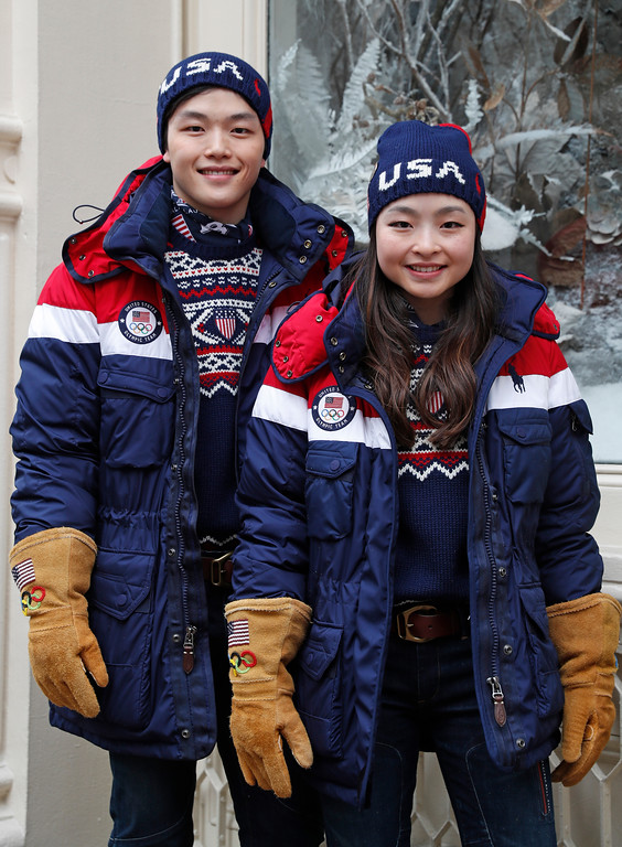 . Sister and brother ice-dancing team Alex and Maia Shibutani pose for photographs wearing Team USA\'s Opening Ceremony uniforms for the upcoming Winter Olympics, Monday, Jan. 22, 2018, in New York. The jackets feature built-in, battery-operated heaters that can be adjusted using a cell phone. (AP Photo/Kathy Willens)