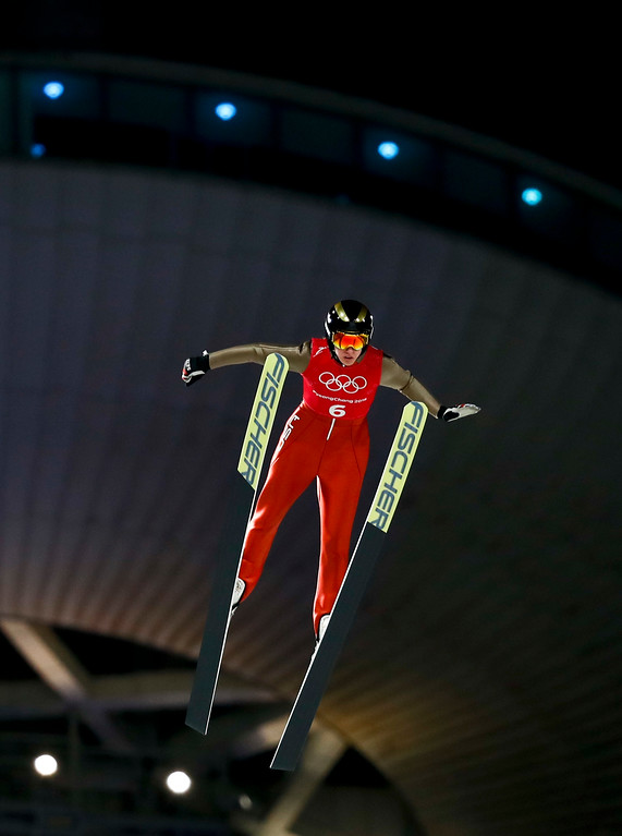. Abby Ringquist, of the United States, soars through the air during training for the women\'s normal hill individual ski jumping competition at the 2018 Winter Olympics in Pyeongchang, South Korea, Sunday, Feb. 11, 2018. (AP Photo/Matthias Schrader)