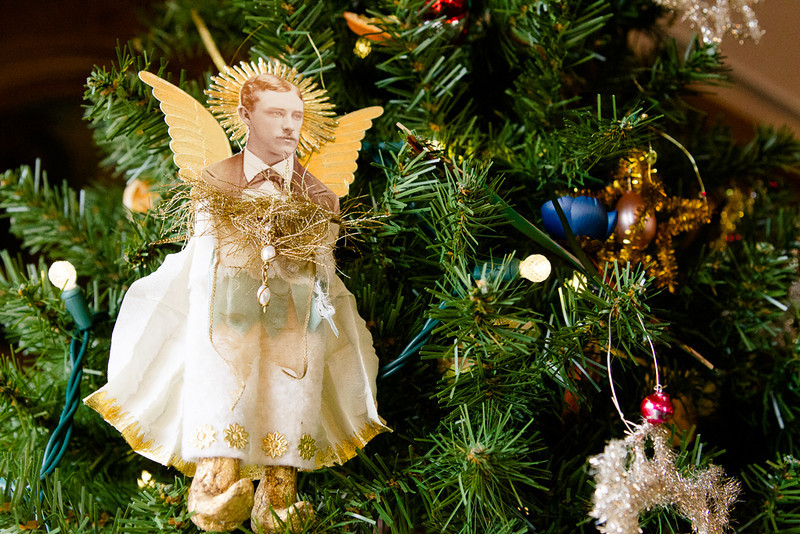 . One of the ornaments on a Victorian tree created by artist Karen Bozik whimsically evokes the Governor\'s mansion\'s roots in the early 1900s. Bozik was the design director for the mansion\'s displays, which have Colorado artists as their theme. Photo by Mark Broste