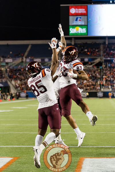 Eric Kumah (83), Chris Cunningham (85) and Deshawn McClease (33) celebrate Kumah's touchdown in the Camping World Bowl between Virginia Tech and Oklahoma State in Orlando, Fl., Thursday, Dec. 28, 2017. (Special by Cory Hancock)