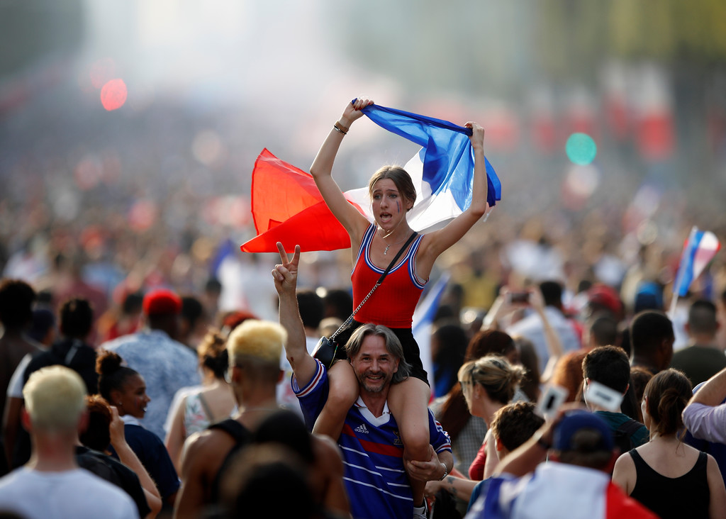 . People celebrate on the Champs Elysees avenue after France won the soccer World Cup final match between France and Croatia, Sunday, July 15, 2018 in Paris. France won its second World Cup title by beating Croatia 4-2 . (AP Photo/Francois Mori)