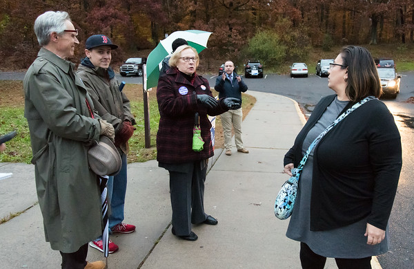 11/06/18 Wesley Bunnell | Staff Rep. Peter Tercyak, L, looks on as State Senator Terry Gerratana speaks to Gloria Sherman as she heads into vote at Pulaski Middle School on Tuesday afternoon.