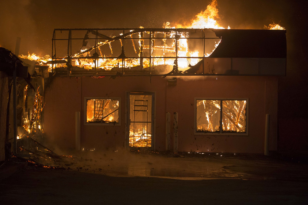. A business burns during rioting on November 25, 2014 in Dellwood, Missouri. Ferguson has been struggling to return to normal after Brown, an 18-year-old black man, was killed by Darren Wilson, a white Ferguson police officer, on August 9. His death has sparked months of sometimes violent protests in Ferguson. A grand jury today declined to indict officer Wilson.  (Photo by Aaron P. Bernstein/Getty Images)