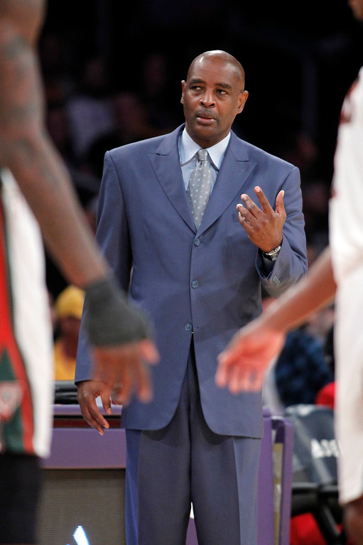 . Milwaukee Bucks coach Larry Drew asks his players to the sidelines for a talk during the second half of an NBA basketball game against the Los Angeles Lakers on Tuesday, Dec. 31, 2013, in Los Angeles. The Bucks won 94-79. (AP Photo/Alex Gallardo)