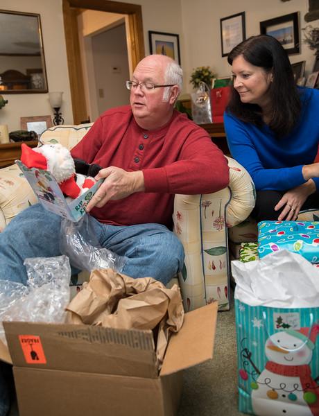Mom and Dad opening farting santa.jpg