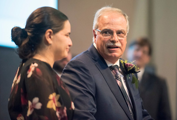 11/21/19 Wesley Bunnell | StaffrrThe Greater New Britain Chamber of Commerce celebrated their 106th year with their annual dinner on Friday night at CCSU. Candace DiCosimo, L, and father and owner of Premier Portraits Jeff DiCosimo. Premier won for Plainville Business of the Year.