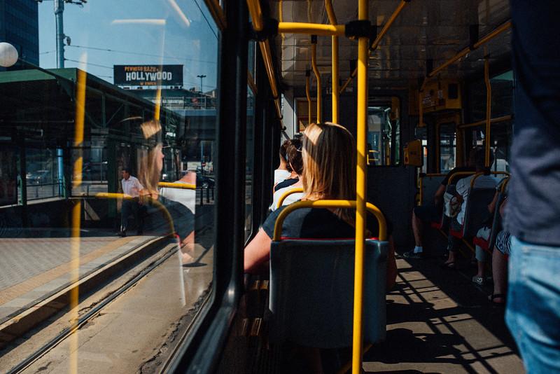 tram reflection woman window metro warsaw summer erik witsoe nikon.jpg