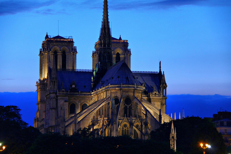 Notre Dame at dusk, taken from the moving tour boat on the Seine River. It took a few tries to get a photo that was not blurry from motion. I blazed away on continuous shooting mode until the view was gone, hoping to get at least one clear image-one is all I got. The handheld exposure took 1/4 second, focal length was 100 MM, image stabilized. This shot would have never happened with image stabilization technology.