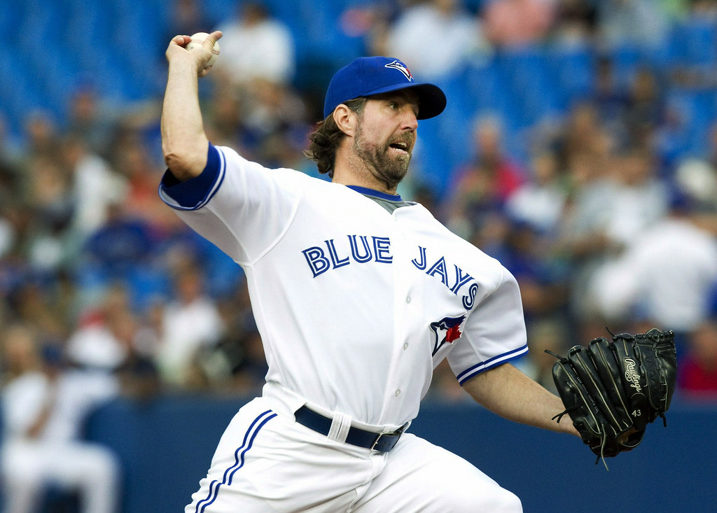 . Toronto Blue Jays starting pitcher R.A.Dickey throws against the Detroit Tigers during the first inning of a baseball game, Friday, Aug. 8, 2014 in Toronto. (AP Photo/The Canadian Press, Fred Thornhill)