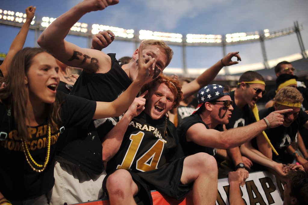 . DENVER, CO. - MAY 18 : J.D. Hall of Arapahoe High School (14) celebrates winning 5A Boy\'s Lacrosse Championship game against Cherry Creek High School with friends at Sports Authority Field at Mile High Stadium. Denver, Colorado. May 18, 2013. Arapahoe won 10-7. (Photo By Hyoung Chang/The Denver Post)