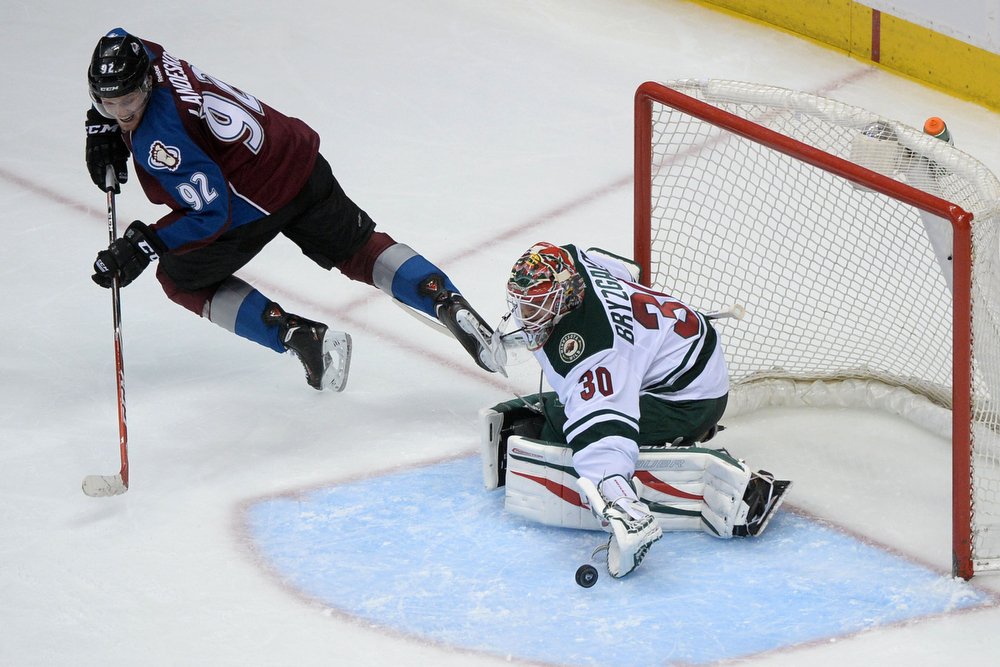 . Gabriel Landeskog (92) of the Colorado Avalanche takes a shot on Ilya Bryzgalov (30) of the Minnesota Wild during the second period of action. The Colorado Avalanche hosted the Minnesota Wild in the first round of the NHL playoffs at the Pepsi Center on Thursday, April 17, 2014. (Photo by Karl Gehring/The Denver Post)
