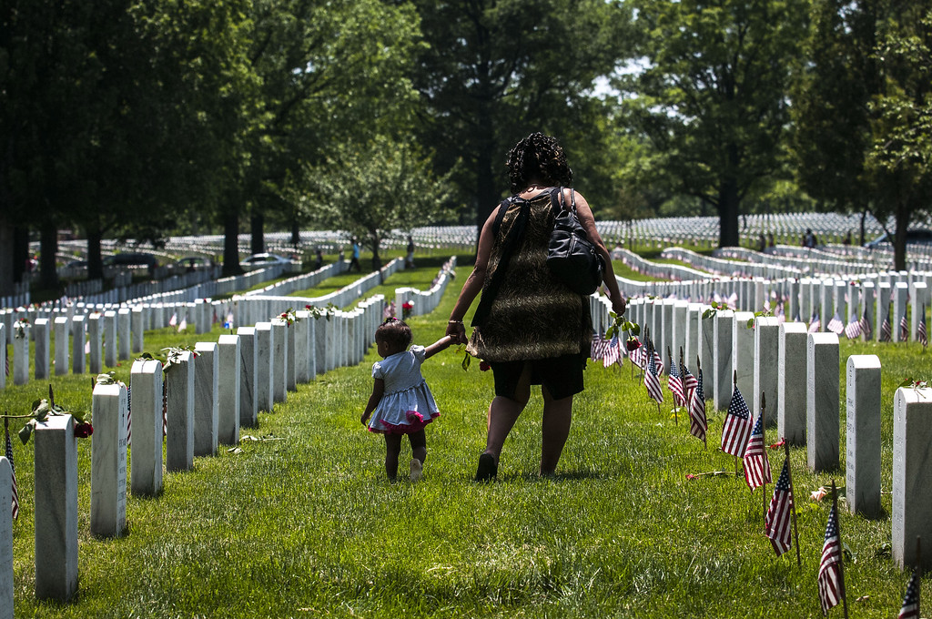 . A mother and daughter stand in Section 60 on Memorial Day at Arlington National Cemetery on May 25, 2015 in Arlington, Va. U.S. President Barack Obama, Chairman of the Joint Chiefs of Staff U.S. Army General Martin Dempsey and U.S. Defense Secretary Ash Carter honored fallen soldiers during a ceremony at Arlington on this Memorial Day.  (Photo by Gabriella Demczuk/Getty Images)