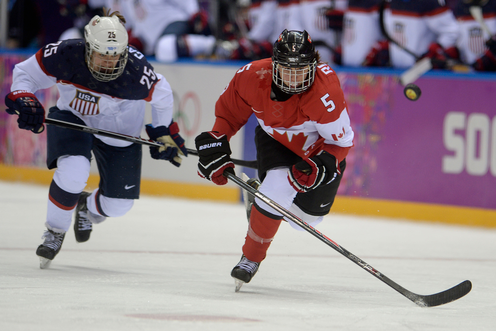 . Lauriane Rougeau (5) of the Canada chases the puck as Alex Carpenter (25) of the U.S.A. pursues during the third period of the women\'s gold medal ice hockey game. Sochi 2014 Winter Olympics on Thursday, February 20, 2014 at Bolshoy Ice Arena. (Photo by AAron Ontiveroz/ The Denver Post)
