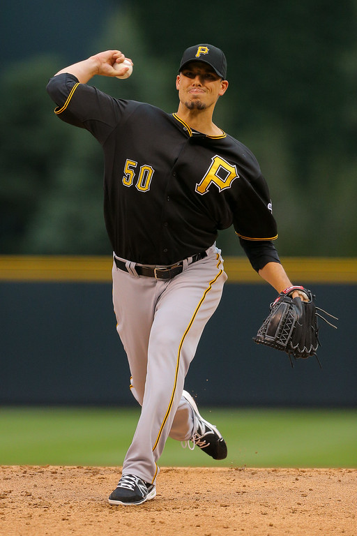 . Starting pitcher Charlie Morton #50 of the Pittsburgh Pirates delivers to home plate during the first inning against the Colorado Rockies at Coors Field on July 25, 2014 in Denver, Colorado. (Photo by Justin Edmonds/Getty Images)