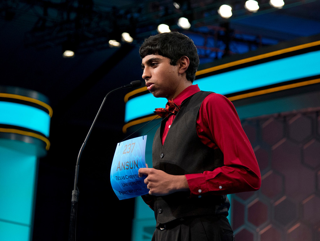 . Ansun Sujoe, of Fort Worth, Texas, spells his word during the finals of the Scripps National Spelling Bee, Thursday, May 29, 2014, at National Harbor in Oxon Hill, Md. Sujoe became the 2014 Scripps National Spelling Bee co-champion with Sriram Hathwar from Painted Post, N.Y.  (AP Photo/Manuel Balce Ceneta)