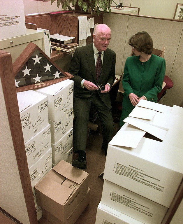 . Senator John Glenn, D-Ohio, left, chats with archivist Coleen Mason, who is going through Senator Glenn\'s collection of memorabilia from 24 years, in his office Friday April 24, 1998, at the Capitol. Glenn was the first man to orbit the earth and will take part in a shuttle flight in Oct. 1998. (AP Photo/Joe Marquette)
