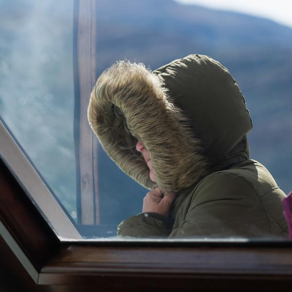 Tourist in winter jacket, Lake Argentino, Los Glaciares National Park, Santa Cruz Province, Patagonia, Argentina