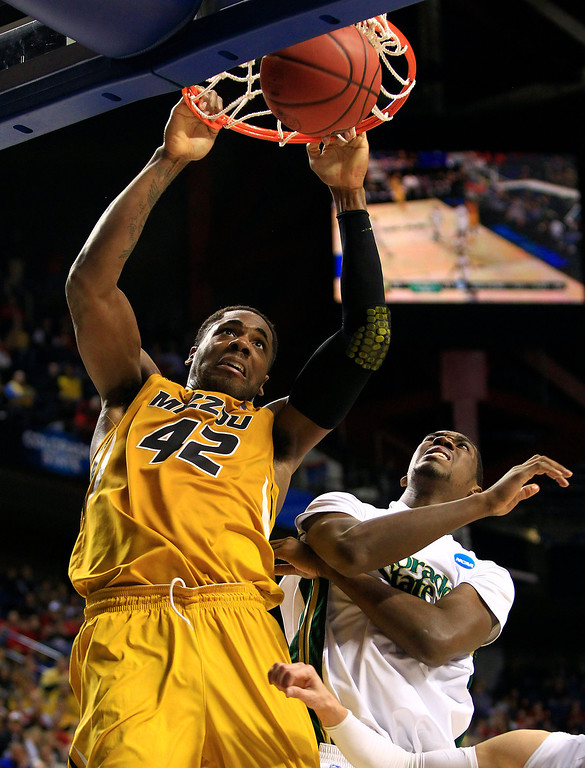 . Missouri forward Alex Oriakhi (42) scores as Colorado State forward Gerson Santo (15) defends during the first half of their second-round NCAA college basketball tournament game on Thursday, March 21, 2013, in Lexington, Ky. (AP Photo/James Crisp)