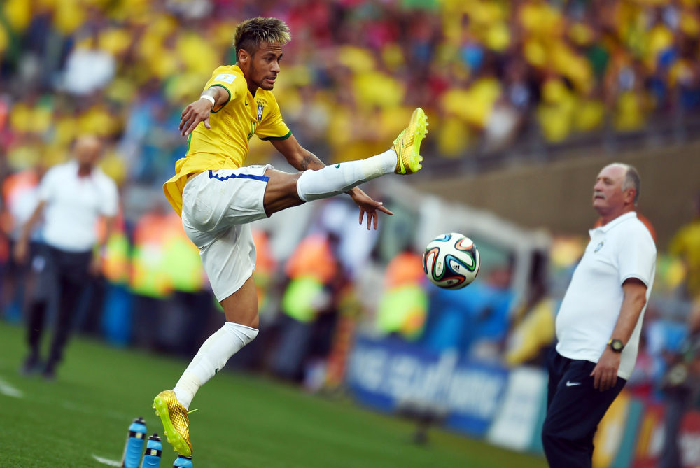 . Brazil\'s forward Neymar controls the ball during the round of 16 football match between Brazil and Chile at The Mineirao Stadium in Belo Horizonte during the 2014 FIFA World Cup on June 28, 2014.  (VANDERLEI ALMEIDA/AFP/Getty Images)