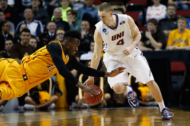 . Derek Cooke Jr. #11 of the Wyoming Cowboys dives to steal the ball from Paul Jesperson #4 of the Northern Iowa Panthers  during the second round of the 2015 Men\'s NCAA Basketball Tournament at KeyArena on March 20, 2015 in Seattle, Washington.  (Photo by Ezra Shaw/Getty Images)