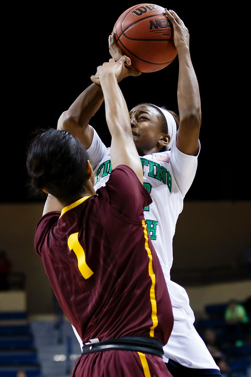 . Notre Dame guard Jewell Loyd (32) is fouled by Arizona State guard Arnecia Hawkins (1) during the second half in a second-round game in the NCAA women\'s college basketball tournament in Toledo, Ohio, Monday, March 24, 2014. (AP Photo/Rick Osentoski)