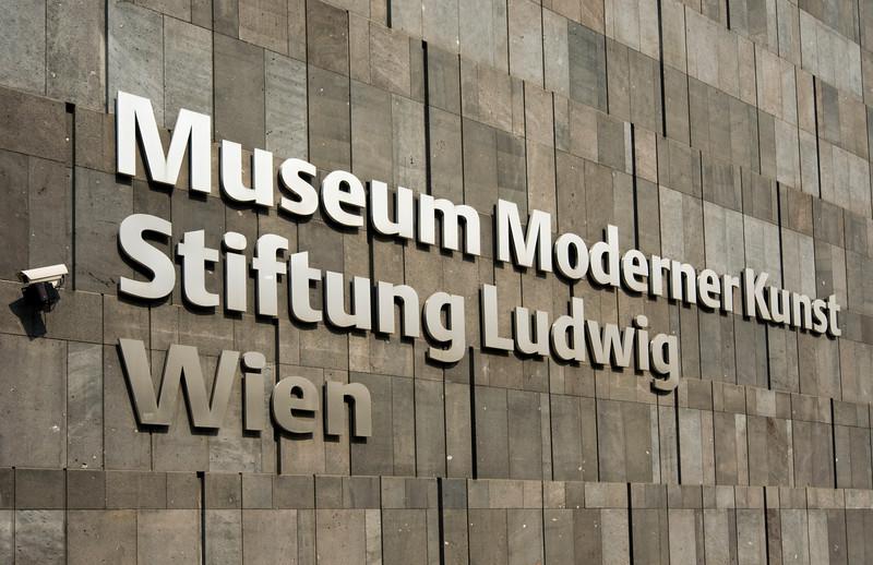 Sign of MUMOK (Museum Moderner Kunst or Museum of Modern Art) on Basalt-lava Stone Facade, MuseumsQuartier in Vienna (Wien), Austria