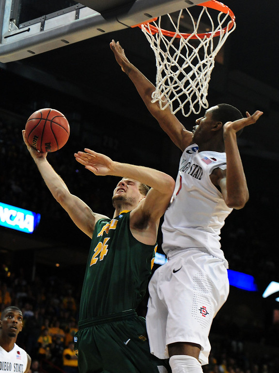 . Taylor Braun #24 of the North Dakota State Bison goes up against Skylar Spencer #0 of the San Diego State Aztecs in the first half during the Third Round of the 2014 NCAA Basketball Tournament at Spokane Veterans Memorial Arena on March 22, 2014 in Spokane, Washington.  (Photo by Steve Dykes/Getty Images)