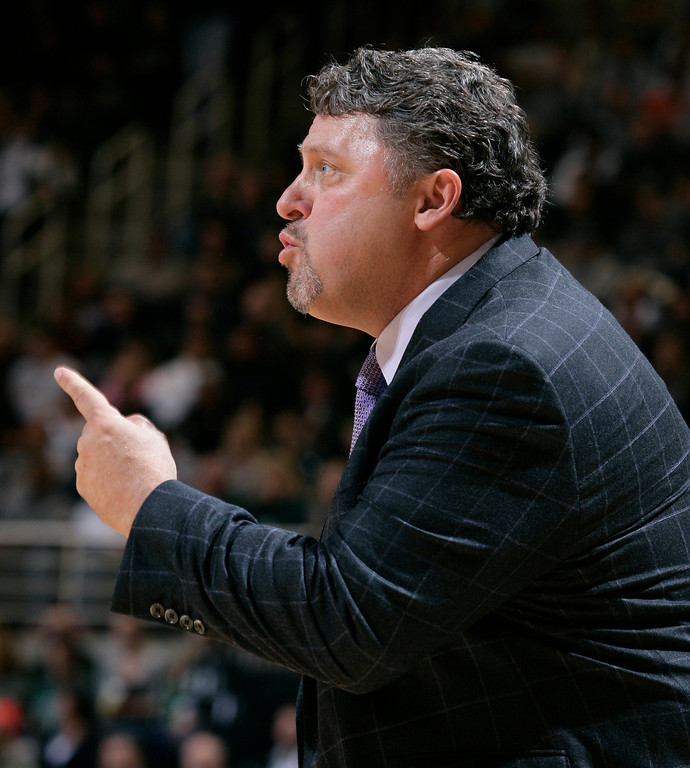 . Oakland coach Greg Kampe gives instructions during the first half of an NCAA college basketball game against Michigan State, Friday, Nov. 23, 2012, in East Lansing, Mich. Michigan State won 70-52. (AP Photo/Al Goldis)