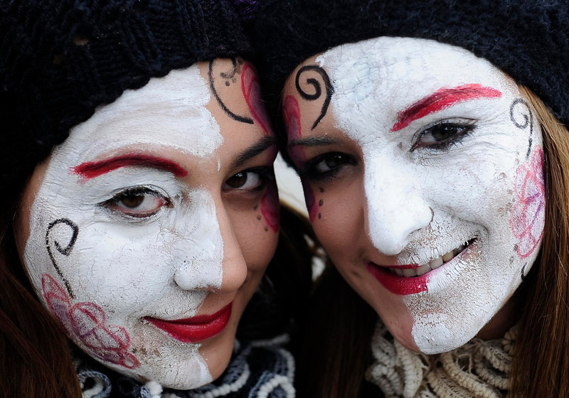 . Revelers pose while parading the streets during a carnival in the village of Vevcani, some 170 km (106 miles) from the Macedonian capital Skopje, January 13, 2013. Vevcani village marks the Orthodox St. Vasilij Day annually with a carnival that features a 1,400-year-old celebration with pagan roots. The highlights of the carnival include a political satire where masked villagers act out current events.  REUTERS/Ognen Teofilovski