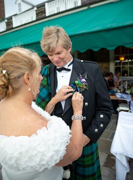 Bride adjusting Grooms Clothing 2.jpg