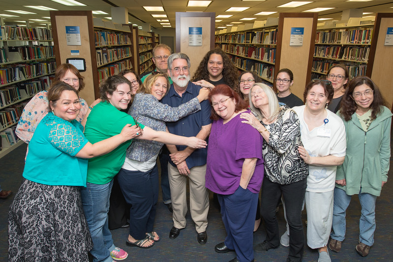 Staff with the Mary and Jeff Bell Library gather around longtime university employee Jeff Janko during his retirement reception on April 13, 2017.