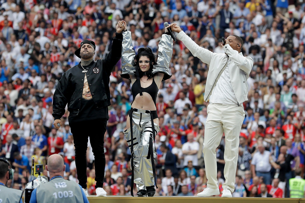 . Singers Nicky Jam, left, Era Istrefi, center, and Will Smith, left, perform during the closing ceremony prior to the final match between France and Croatia at the 2018 soccer World Cup in the Luzhniki Stadium in Moscow, Russia, Sunday, July 15, 2018. (AP Photo/Matthias Schrader)