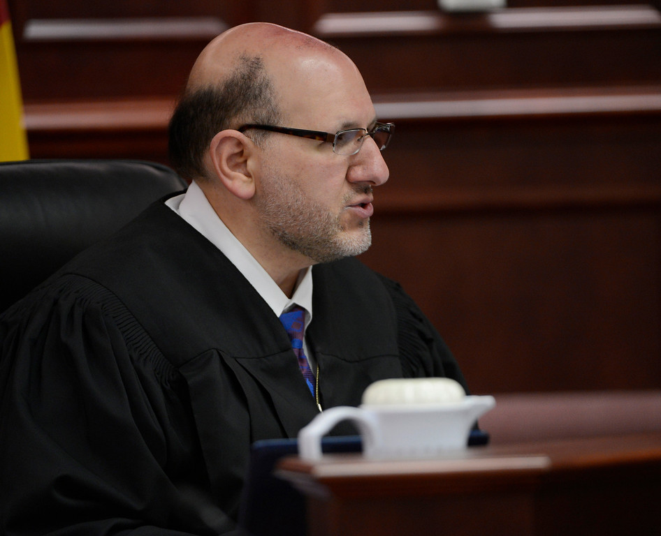 . Judge Carlos A. Samour Jr. speaks during a hearing for Aurora theater shooting suspect James Holmes in Centennial, Colo., on Tuesday, June 4, 2013. Samour accepted  plea of not guilty by reason of insanity from Holmes.  He also ruled that prosecutors can have access to a notebook Holmes sent to a psychiatrist before last summer\'s rampage. (AP Photo/The Denver Post, Andy Cross, Pool)