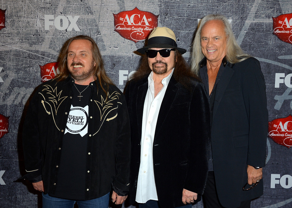 . LAS VEGAS, NV - DECEMBER 10:  (L-R) Johnny Van Zant, Gary Rossington and Rickey Medlocke of Lynyrd Skynyrd arrive at the 2012 American Country Awards at the Mandalay Bay Events Center on December 10, 2012 in Las Vegas, Nevada.  (Photo by Frazer Harrison/Getty Images)