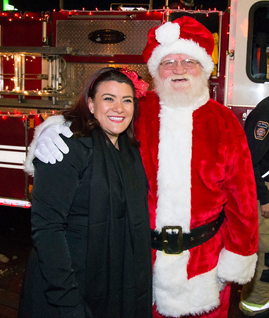12/05/19 Wesley Bunnell | Staff The New Britain Christmas tree was lit on Thursday night in Central Park complete with a visit from Santa Clause who rode in on a NBFD fire truck. Mayor Erin Stewart was present to greet Santa.