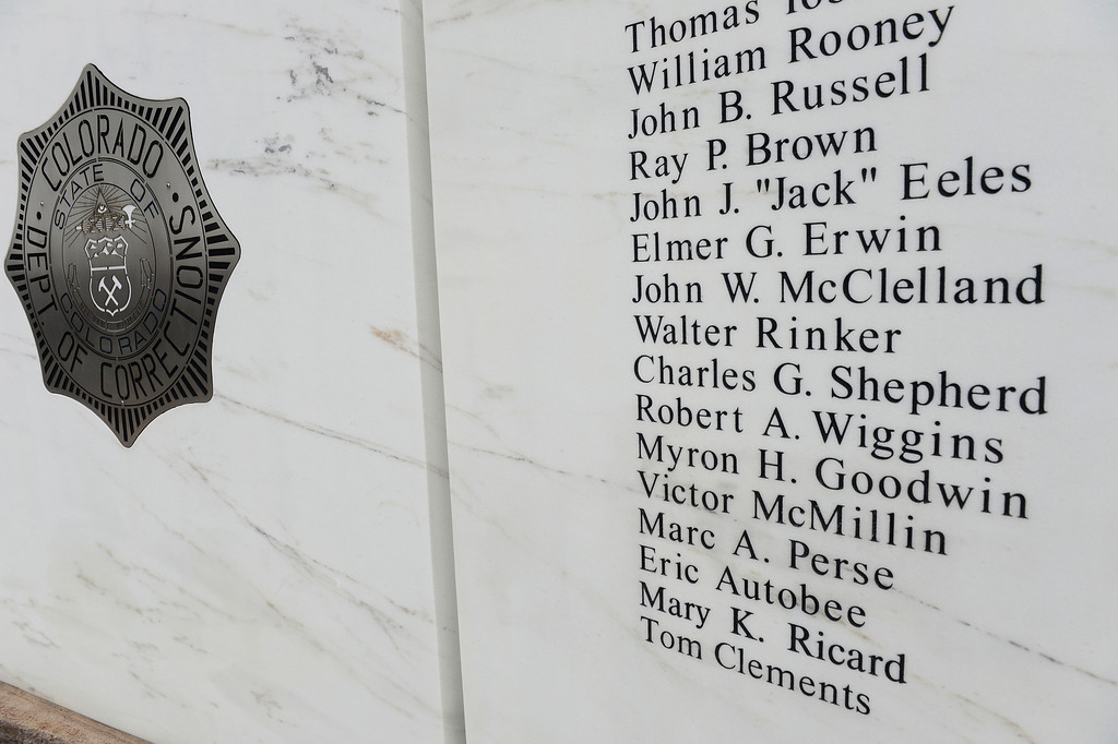 . Tom Clements\' name was added to the marble memorial and revealed at the Colorado Department of Corrections Fallen Officer Memorial honoring the head of the DOC, March 15, 2014. (Photo By Andy Cross / The Denver Post)