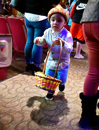 4/20/2019 Mike Orazzi | Staff Kayden Santana-Figueroa,3, during the 6th annual Easter Egg Hunt held at Trinity-On-Main in downtown New Britain on Saturday.