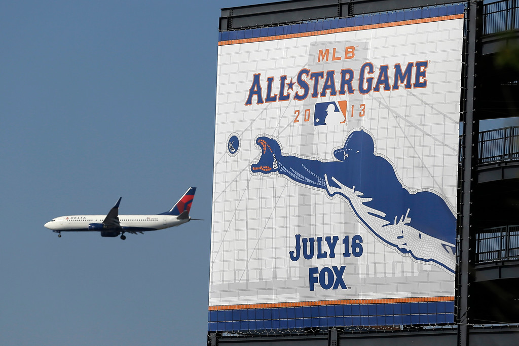 . A plane flies past Citi Field on its way to La Guardia Airport before the MLB All-Star baseball game between the National and American Leagues, on Tuesday, July 16, 2013, in New York. (AP Photo/Julio Cortez)